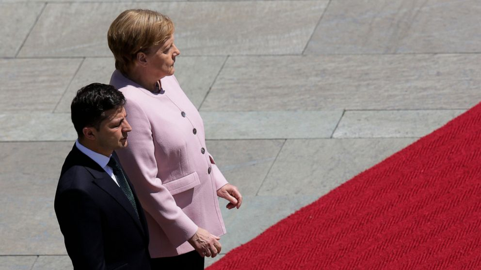 Germany's Merkel appears unsteady, shaking at ceremony thumbnail