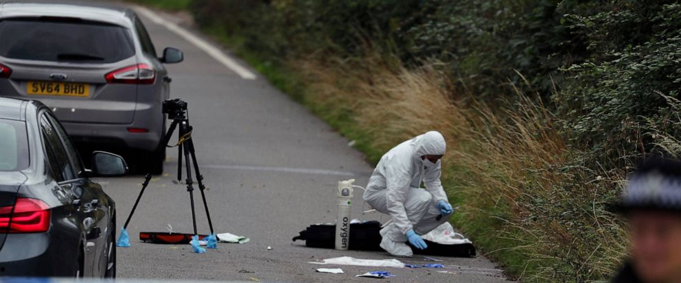 A police investigator at the scene of an incident where a police officer was killed, near Sulhamstead, England, Friday, Aug. 16, 2019. Thames Valley police say a British police officer investigating a reported burglary has been killed. Ten males have