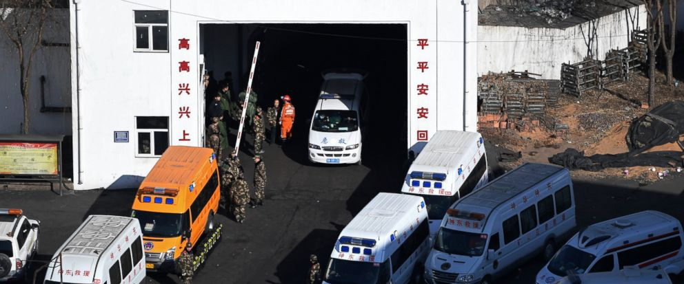 In this photo released by Xinhua News Agency, ambulance vehicles and rescuers gather at the Lijiagou coal mine of the Baiji Mining Co., Ltd. in Shenmu City, northwest Chinas Shaanxi Province, Sunday, Jan. 13, 2019. Twenty-one coal miners were killed