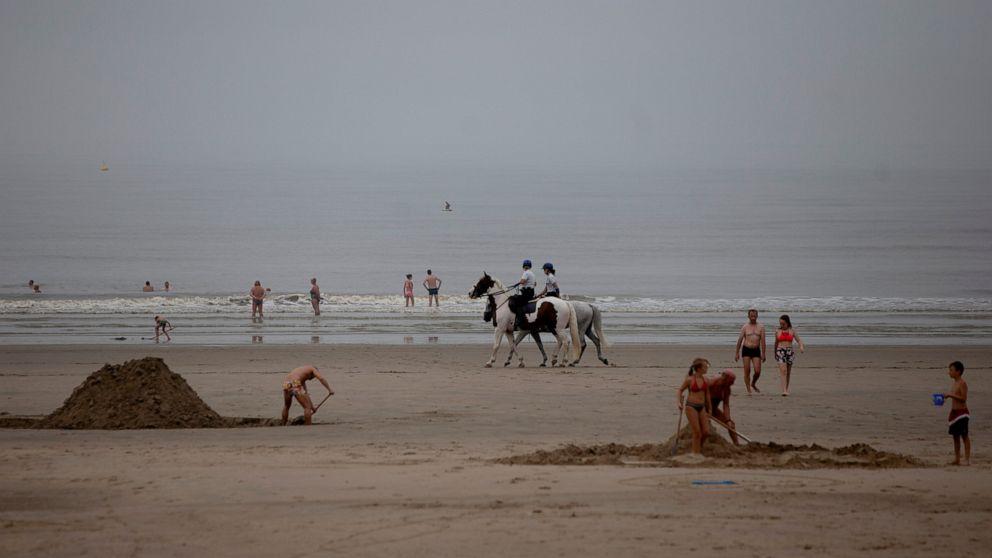 Belgian beach brawl fuels virus, political, climate tension