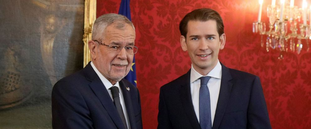 Austrian President Alexander Van der Bellen, left, welcomes Sebastian Kurz, right, head of the Austrian Peoples Party, OEVP, prior to their talks at the Hofburg palace in Vienna, Austria, Monday, Oct. 7, 2019. Kurz will get the order to form a new g