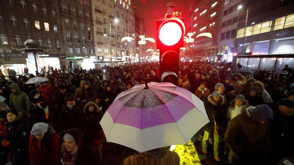People march during a protest against populist President Aleksandar Vucic in Belgrade, Serbia, Saturday, Jan. 5, 2019. Thousands of people have protested in Serbia for a fifth consecutive week over what they say has been a stifling of democratic freedoms under President Aleksandar Vucic. (AP Photo/Darko Vojinovic)