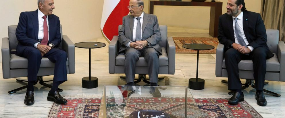 In this photo released by the Lebanese Government, Lebanese President Michel Aoun, center, meets with Prime Minister Saad Hariri, right, and Parliament Speaker Nabih Berri, left, at the Presidential Palace in Baabda, east of Beirut, Lebanon, Friday,