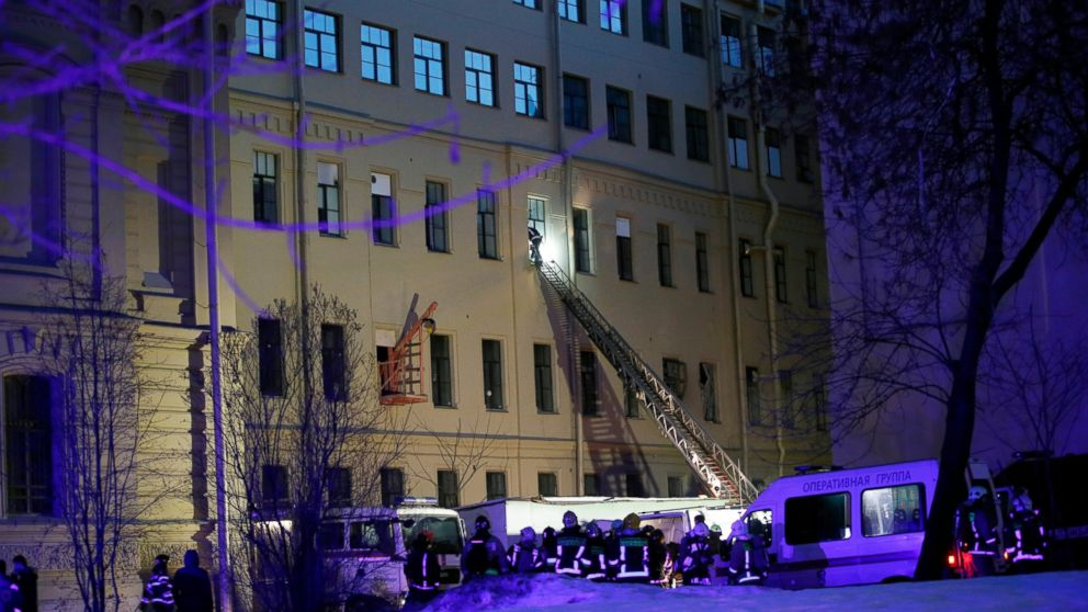 Russian Emergency employees work at the scene of the collapse building of the Saint Petersburg National Research University of Information Technologies, Mechanics and Optics in St. Petersburg, Russia, Saturday, Feb. 16, 2019. Russian emergency authorities say several floors of a university building in Russia's second-largest city have collapsed. There was no immediate information on casualties. (AP Photo/Dmitri Lovetsky)