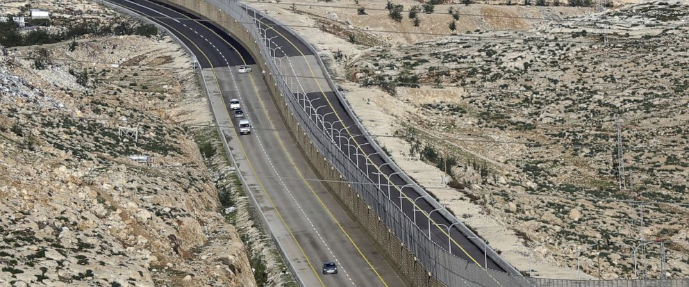 FILE - This Jan. 10, 2019 file photo, shows a newly opened segregated West Bank highway near Jerusalem. Israels government went on a spending binge in its West Bank settlements following the election of President Donald Trump, according to official
