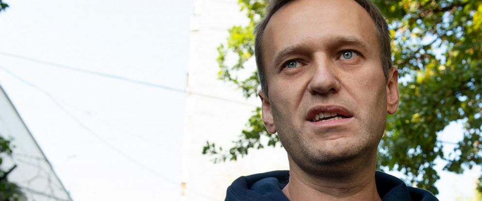 FILE - In this Friday, Aug. 23, 2019 file photo, Russian opposition leader Alexei Navalny speaks to the media as he leaves a detention center after his release, in Moscow, Russia. Russian officials have designated the nonprofit organization behind ma
