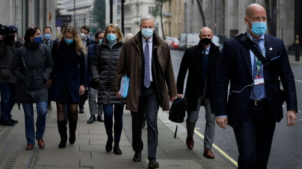 EU Chief Negotiator Michel Barnier, centre, with his team as he walks to a conference centre in Westminster in London, Sunday, Nov. 29, 2020. Teams from Britain and the European Union are continuing face-to-face talks on a post-Brexit trade deal in t