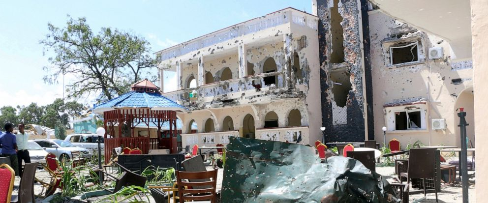 A view of Asasey Hotel after an attack, in Kismayo, Somalia, Saturday July 13, 2019. At least 10 people, including two journalists, were killed in an extremist attack Friday on a hotel in the port city of Kismayo, a Somali official said. The attack s