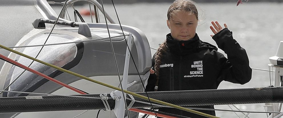 Climate change activist Greta Thunberg waves from the Malizia II boat in Plymouth, England, Wednesday, Aug. 14, 2019. The 16-year-old climate change activist who has inspired student protests around the world will leave Plymouth, England, bound for N