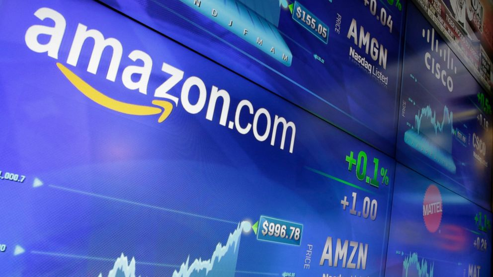 FILE - In this Tuesday, May 30, 2017, file photo, the Amazon logo is displayed at the Nasdaq Market Site, in New York's Times Square. Germany's finance minister on Wednesday welcomed an agreement requiring large companies in the European Union to rev