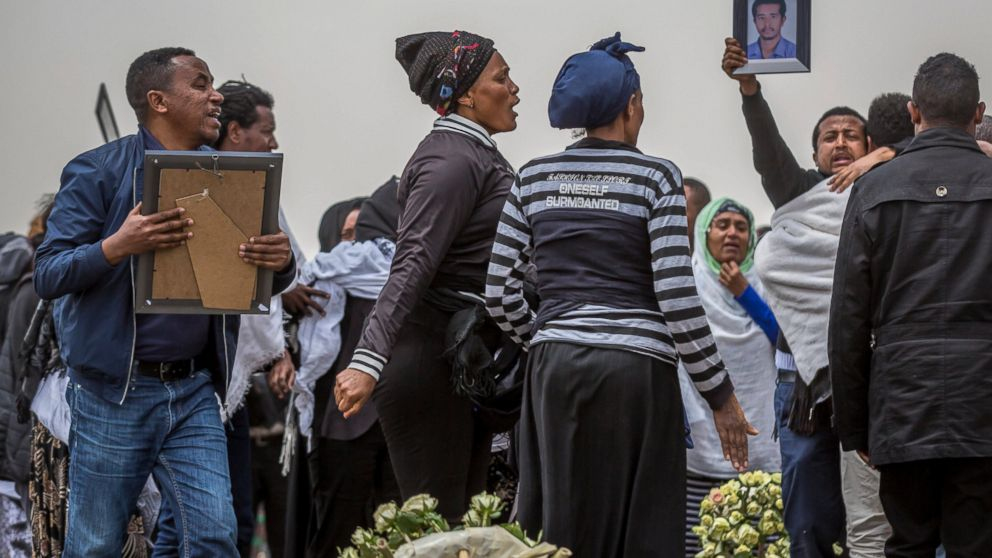 Ethiopian relatives of crash victims mourn at the scene where the Ethiopian Airlines Boeing 737 Max 8 crashed shortly after takeoff on Sunday killing all 157 on board, near Bishoftu, south-east of Addis Ababa, in Ethiopia Thursday, March 14, 2019. About 200 family members of people who died on the crashed jet stormed out of a briefing with Ethiopian Airlines officials in Addis Ababa on Thursday, complaining that the airline has not given them adequate information. (AP Photo/Mulugeta Ayene)