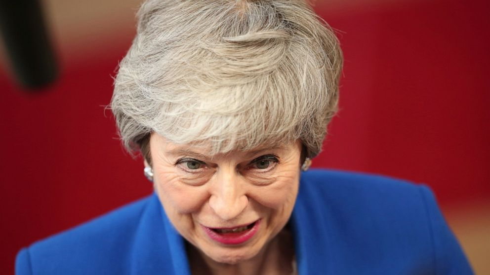 British Prime Minister Theresa May speaks as she arrives for an EU summit at the Europa building in Brussels, Wednesday, April 10, 2019. European Union leaders meet Wednesday in Brussels for an emergency summit to discuss a new Brexit extension. (AP Photo/Francisco Seco)