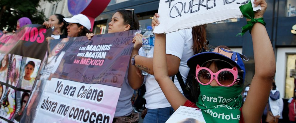 """A woman holds the message """"We want to be alive"""" during a silent march to remember murdered women and demand justice for them in Mexico City, Sunday, Sept. 8, 2019. Hundreds of women have taken to the streets of Mexico City to demand justice for loved"""