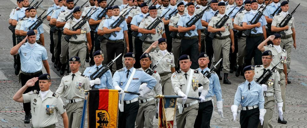 German soldiers march on the Champs-Elysees avenue during the Bastille Day parade in Paris, France, Sunday July 14, 2019. (AP Photo/Michel Euler)