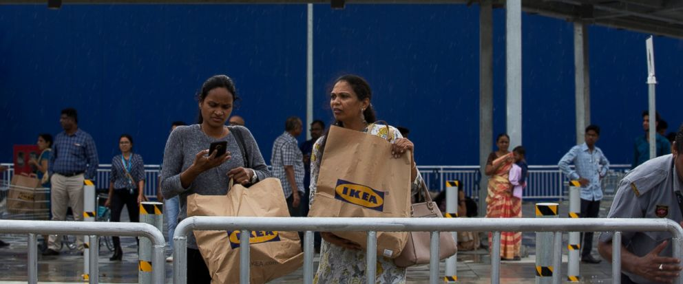 FILE - In this Aug.9, 2018, file photo, Indian customers return after shopping at IKEAs first store in India as it opened in Hyderabad, India. Swedish home furnishings giant Ikea announced plans on Friday, Jan. 11, 2019, to open its first New Zealan