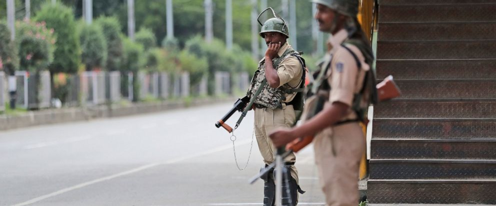 Indian paramilitary soldiers stand guard during a security lockdown in Srinagar, Indian controlled Kashmir, Monday, Aug. 12, 2019. Troops in India-administered Kashmir allowed some Muslims to walk to local mosques alone or in pairs to pray for the Ei