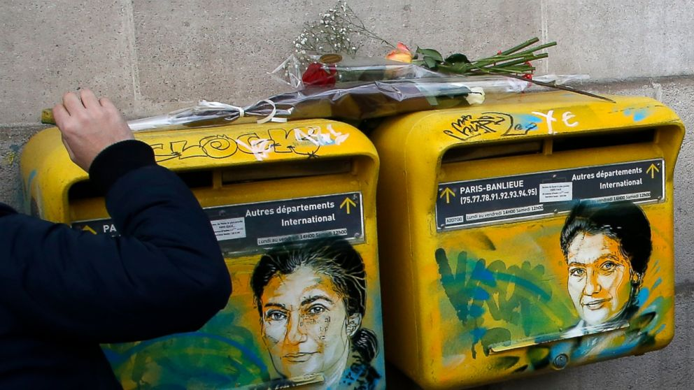 French street artist Christian Guemy, known as C215, cleans the vandalized mailboxes with swastikas covering the face of the late Holocaust survivor and renowned French politician, Simone Veil, in Paris, Tuesday Feb.12, 2019. According to French authorities, the total of registered anti-Semitic acts rose to 541 in 2018 from 311 in 2017, a rise of 74 percent. (AP Photo/Michel Euler)