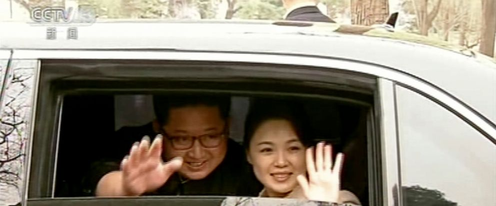 FILE - In this file image taken from video footage run on March 28, 2018, by Chinas CCTV via AP Video, North Korean leader Kim Jong Un and his wife Ri Sol Ju wave from a car as they bid farewell to Chinese counterpart Xi Jinping and his wife Peng Li