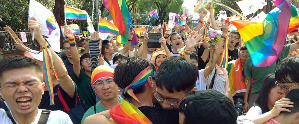 Same-sex marriage supporters hug outside the Legislative Yuan in Taipei, Taiwan, Friday, May 17, 2019, after Taiwans legislature has passed a law allowing same-sex marriage in a first for Asia. The vote Friday allows same-sex couples full legal marr