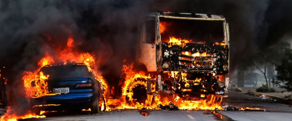 Vehicles burn in the street after attacks in the city of Fortaleza, northeastern Brazil, Thursday, Jan. 3, 2019. Brazils newly inaugurated government has ordered military police sent to Ceara state following a wave of attacks on banks, public buildi