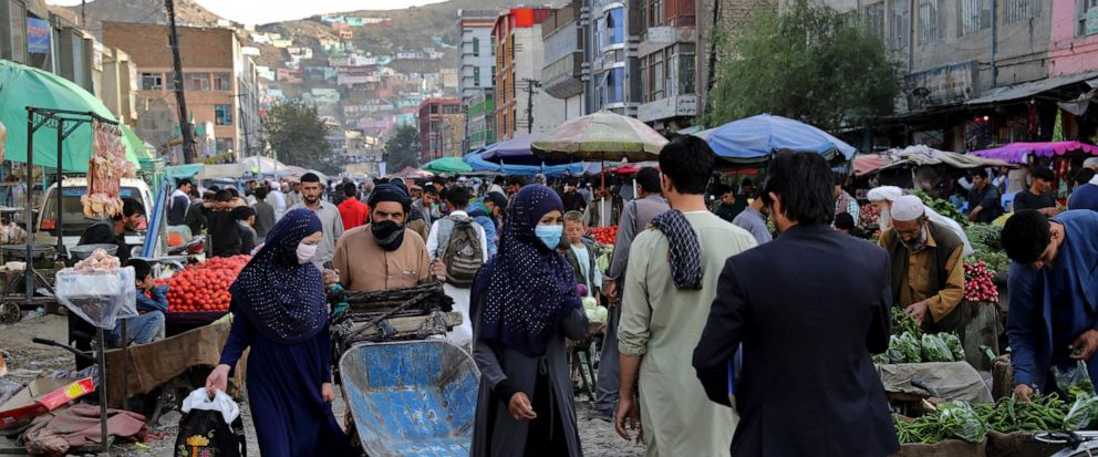 People shop at a market in the old city of Kabul, Afghanistan, Sunday, Sept. 8, 2019. (AP Photo/Ebrahim Noroozi)
