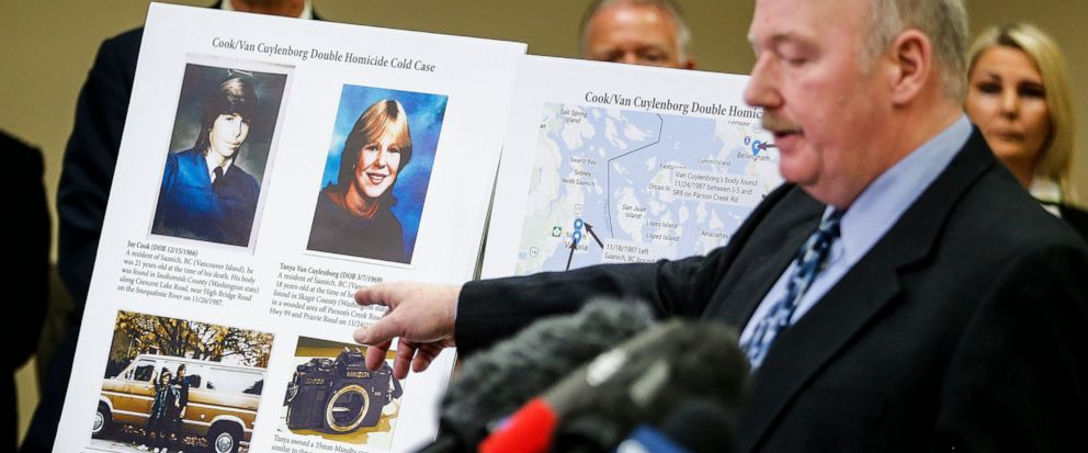 FILE - In this April 11, 2018, file photo, Snohomish County Cold Case Detective Jim Scharf, right, shares details of the unsolved case of the 1987 double homicide of Jay Cook and Tanya Van Cuylenborg, during a press conference in Everett, Wash. Willi