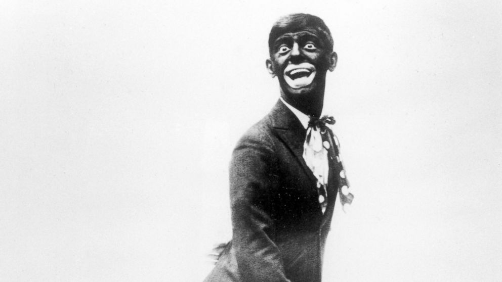 """FILE - This 1920s image shows comedian Eddie Cantor wearing blackface while performing """"If You Knew Susie."""" Blackface minstrelsy is considered by some to be the first uniquely American form of entertainment. White men would darken their faces to create caricatures of black people, including large mouths, lips and eyes, woolly hair and coal-black skin. (AP Photo/File)"""