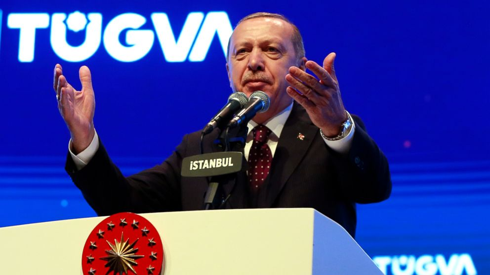 Turkey's President Recep Tayyip Erdogan addresses a meeting of a youth organisation founded by his elder son Bilal Erdogan and his friends, in Istanbul Saturday, Dec. 22, 2018. Erdogan said Friday the United States decided to withdraw troops from Syria after he reassured U.S. President Donald Trump that Turkey could eradicate the remnants of Islamic State group from the country with logistical help from Washington.(Presidential Press Service via AP, Pool)