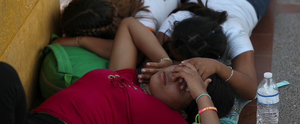 Migrant women sleep after camping out on the Gateway International Bridge that connects downtown Matamoros, Mexico with Brownsville, Thursday, Oct. 10, 2019. Migrants wanting to request asylum camped out on the international bridge leading from Mexic