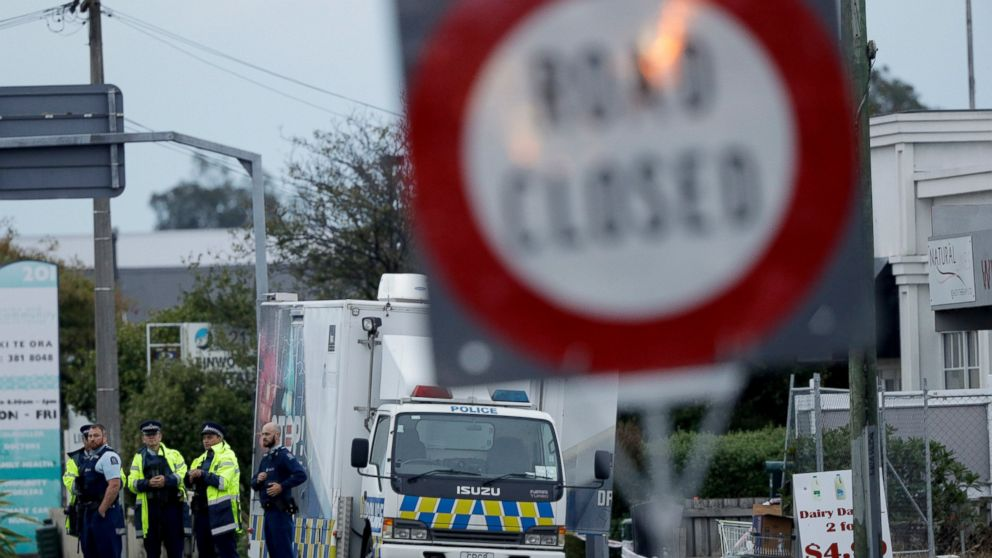 Police gather outside the Linwood mosque, site of one of the mass shootings at two mosques in Christchurch, New Zealand, Saturday, March 16, 2019. (AP Photo/Mark Baker)