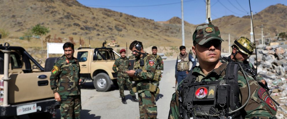 Afghan special forces stand guard at the site of a suicide car bomb explosion that killed at least four people, on the outskirts of Kabul, Afghanistan, Thursday, Sept. 12, 2019. Taliban spokesman Zabihullah Mujahid has claimed responsibility for the