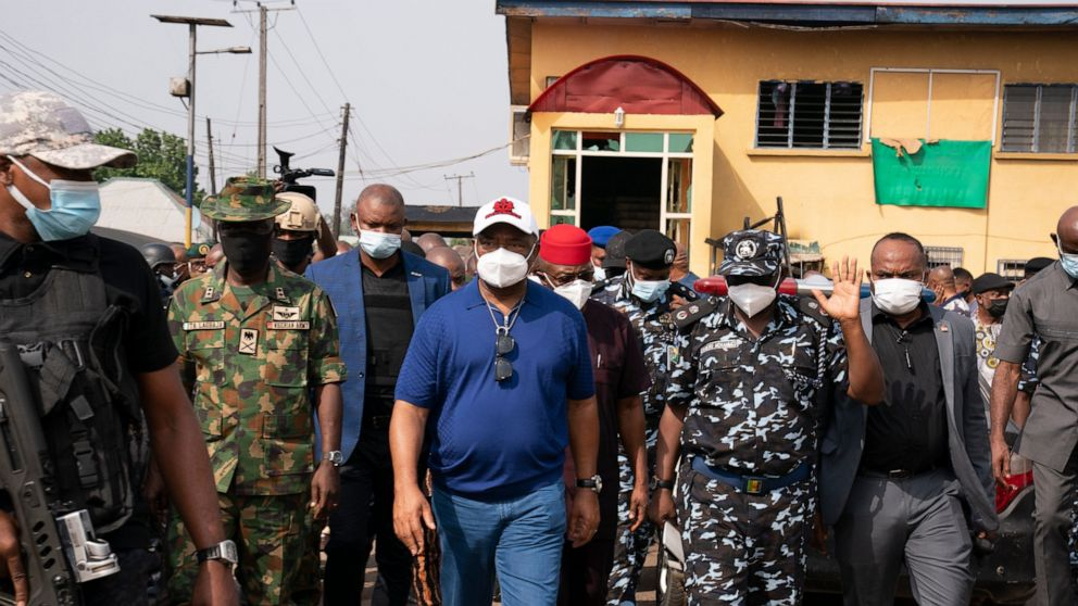 Imo state Gov. Hope Uzodinma, center, inspects the scene of an attack at the police command headquarters in Owerri, Nigeria, on Monday, April 5, 2021. Hundreds of inmates escaped from a prison in the southeastern Nigerian city after a series of coord