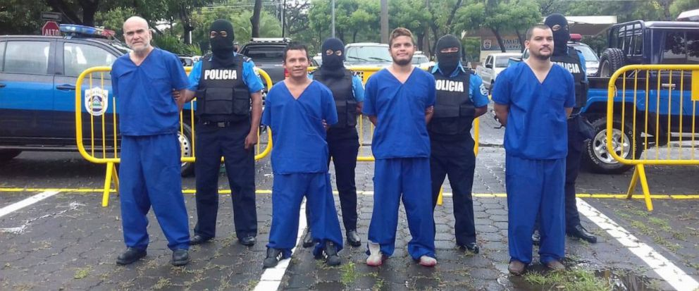 In this Oct. 17, 2018 photo, provided by the Nicaraguan National Police, prisoners detained and imprisoned during the recent uprisings against the government of President Daniel Ortega, are shown to the press in Managua, Nicaragua. At left is Eddy An
