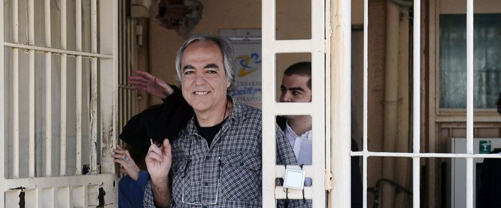 """FILE - In this Thursday, Nov. 9, 2017 file photo, Dimitris Koufodinas smiles as he leaves Korydallos prison in western Athens. A Greek far-left extremist serving 11 life terms for a string of murders is vowing to continue """"until the end"""" with a hunge"""
