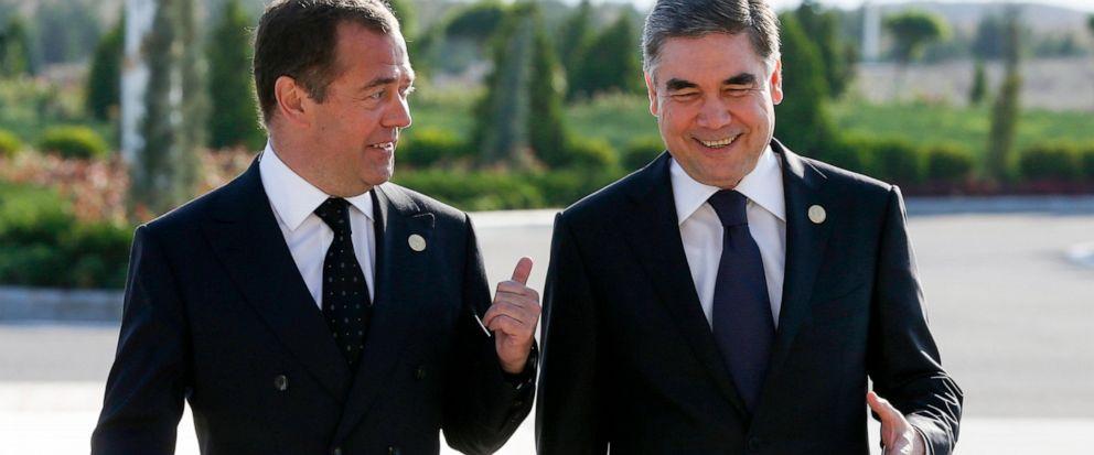 Russian Prime Minister Dmitry Medvedev, left, and Turkmenistans President Gurbanguly Berdymukhamedov speak, prior to a session of the First Caspian Economic Forum in Turkmenbashi, Turkmenistan, Monday, Aug. 12, 2019. (Dmitry Astakhov, Sputnik, Gover