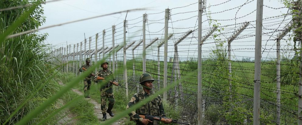 Indias Border Security Force (BSF) soldiers patrol near the India Pakistan border fencing at Garkhal in Akhnoor, about 35 kilometers (22 miles) west of Jammu, India, Tuesday, Aug.13, 2019. Pakistan has denounced India's actions to change the special