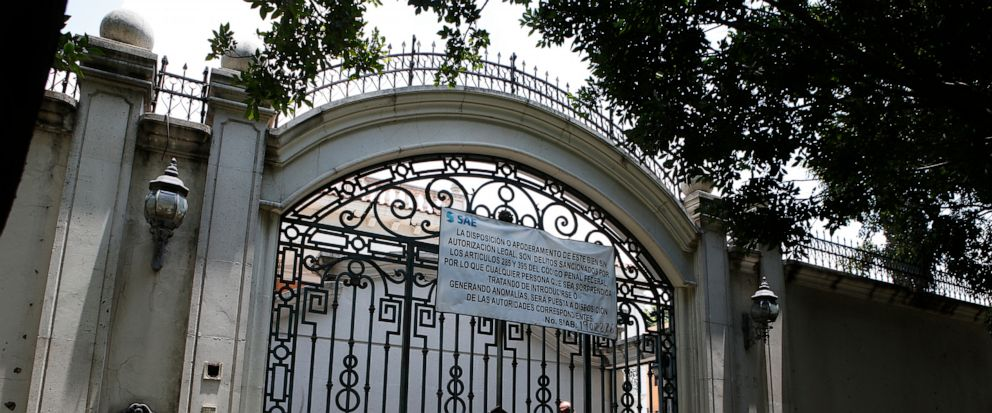 The entrance gate to the mansion of Chinese-Mexican businessman Zhenli Ye Gon during a media tour in Mexico City, Tuesday, July 30, 2019. The federal government said Monday it will hold an Aug. 11 auction for the Mexico City mansion worth $5 million