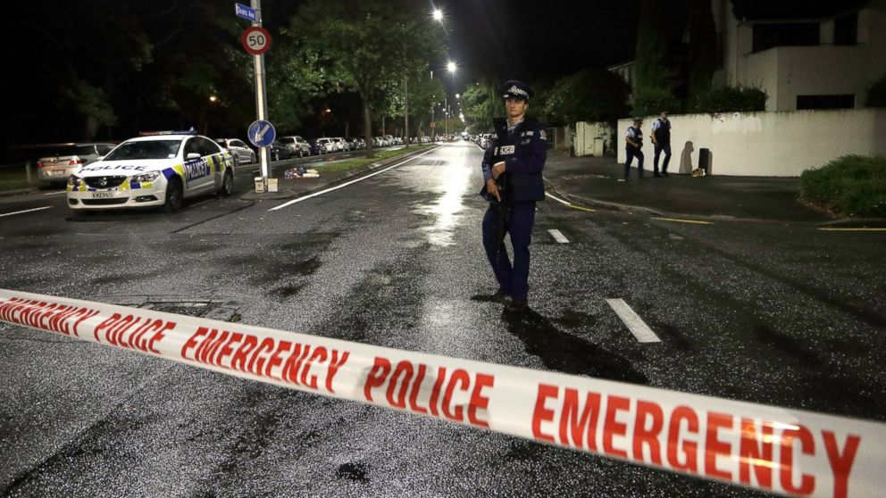 """A police officer patrols at a cordon near a mosque in central Christchurch, New Zealand, Friday, March 15, 2019. Multiple people were killed in mass shootings at two mosques full of worshippers attending Friday prayers on what the prime minister called """"one of New Zealand's darkest days,"""" as authorities detained four people and defused explosive devices in what appeared to be a carefully planned attack. (AP Photo/Mark Baker)"""