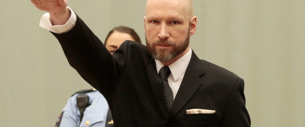 FILE - In this Tuesday, Jan. 10, 2017 file photo, Anders Behring Breivik raises his right hand at the start of his appeal case in Borgarting Court of Appeal at Telemark prison in Skien, Norway, Tuesday, Jan. 10, 2017. The manifesto that the presumed