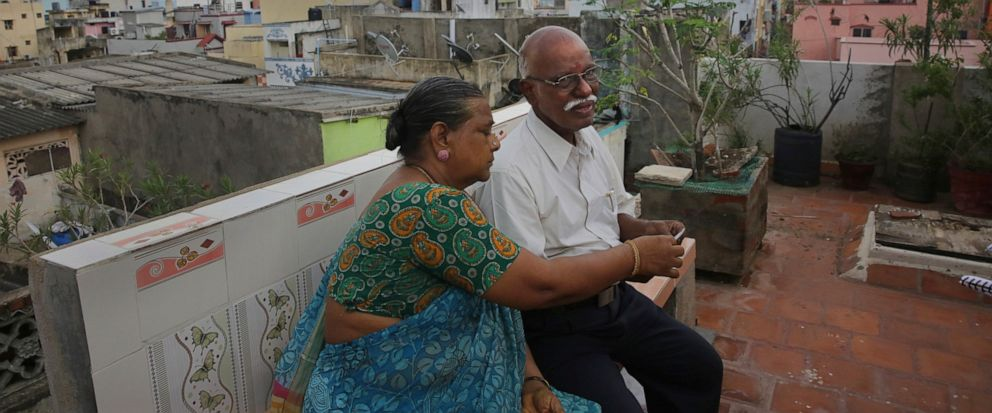 In this July 18, 2019, photo, retired Indian civil servant R. Devarajan with his wife Padmini sit at the terrace of their house equipped with rain water harvesting system in Chennai, India. For Devarajan and Padmini, Chennais acute water shortage ha