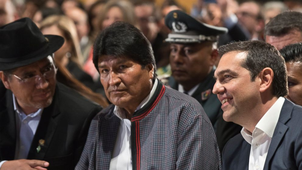 Bolivian President Evo Morales, center, and Greece's Prime Minister Alexis Tsipras, right, take part in a conference in Athens, Thursday, March 14, 2019. Morales is in Greece on a two-day official visit. (AP Photo/Petros Giannakouris)