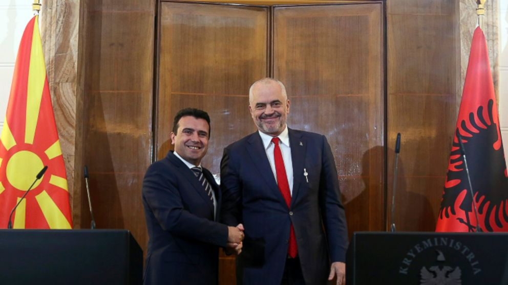 North Macedonia's Prime Minister Zoran Zaev, left, and his Albanian counterpart shake hands during their meeting in Tirana, Wednesday, March 13, 2019. The two leaders say they believe that the European Union will decide in June to open membership talks with them. (AP Photo)