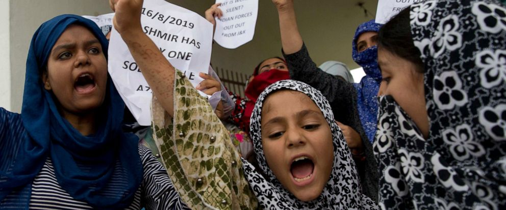 Kashmiri Muslim girls shout pro-freedom slogans during a demonstration after Friday prayers amid curfew like restrictions in Srinagar, India, Friday, Aug. 16, 2019. Indias government assured the Supreme Court on Friday that the situation in disputed