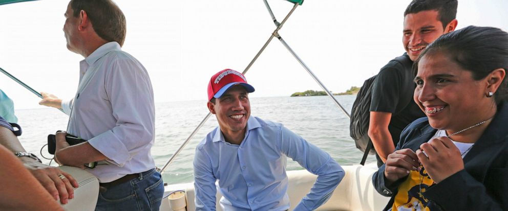 Juan Guaidó, opposition leader and self-proclaimed interim president of Venezuela, sits on a boat with staff members before crossing Maracaibo Lake to reach the town of Cabimas, Venezuela where he will lead a rally, Sunday, April 14, 2019. Guaidó was