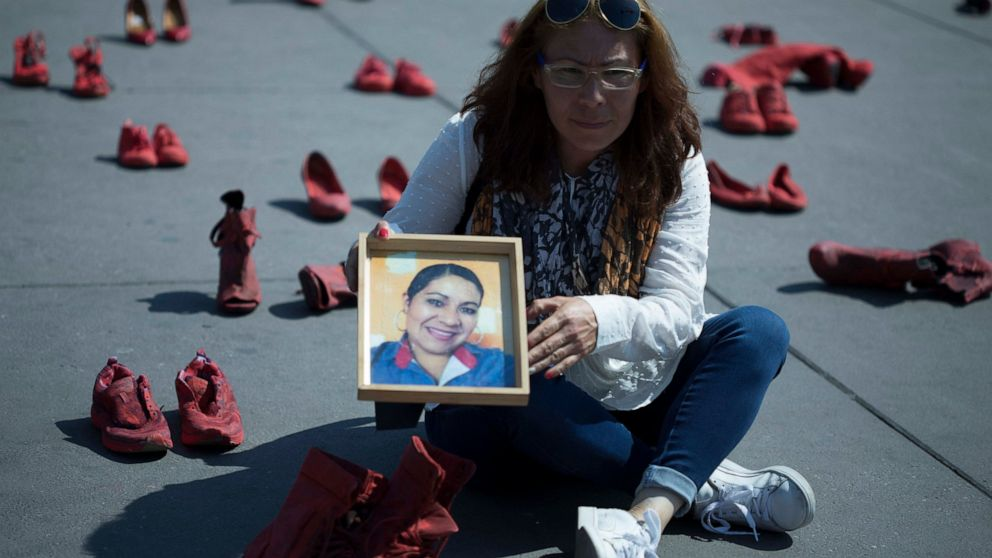 In Mexican capital, red shoes to protest killings of women thumbnail