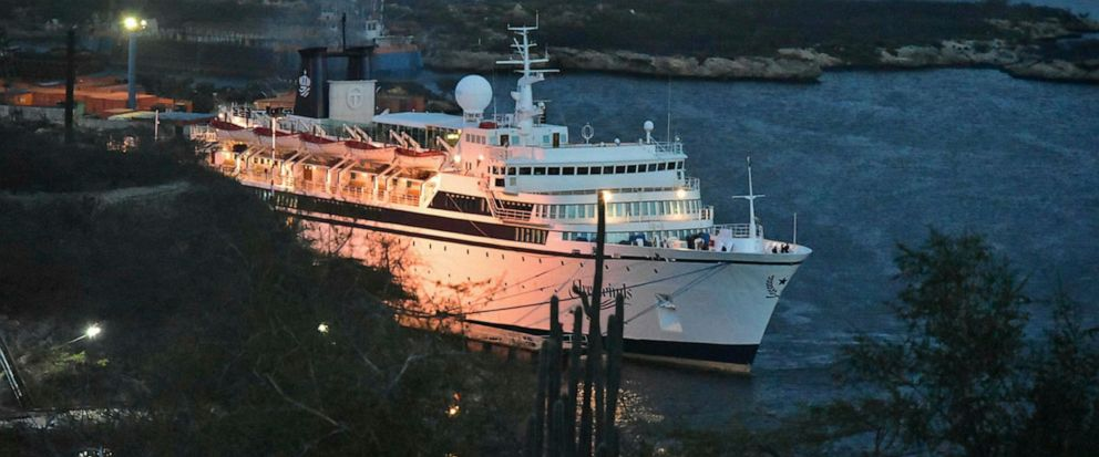 The Freewinds cruise ship is docked in the port of Willemstad, Curacao Saturday, May 4, 2019. Authorities in Curacao on Saturday boarded the ship that arrived in the Dutch Caribbean island under quarantine, to start vaccinating people to prevent a me