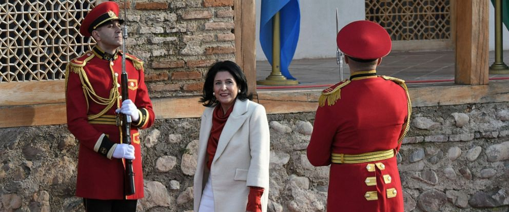 "FILE In this file photo taken on Sunday, Dec. 16, 2018, Georgian President Salome Zurabishvili arrives to attend her inauguration in Telavi, Georgia. Georgias president says shell ""wait and see"" how a debate in Russia about possible new sanctions a"