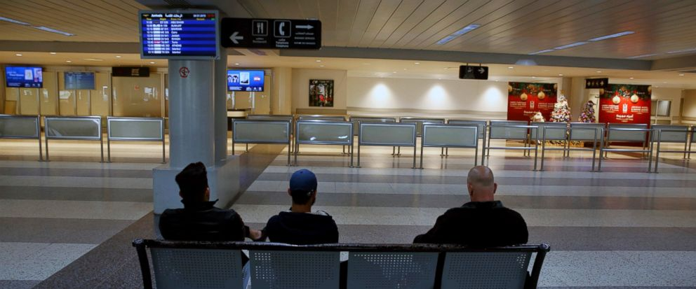 People wait at the almost empty arrival hall of the Rafik Hariri International Airport during a strike in Beirut, Lebanon, Friday, Jan. 4, 2019. Parts of Lebanons public and private sectors have gone into a strike called for by the countrys labor u