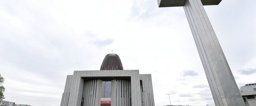 People walk by the Temple of Divine Providence, a major church in the Polish capital,in Warsaw, Poland, Monday, May 13, 2019. A new documentary about pedophile priests has deeply shaken Poland, one of Europes most Roman Catholic societies, eliciting