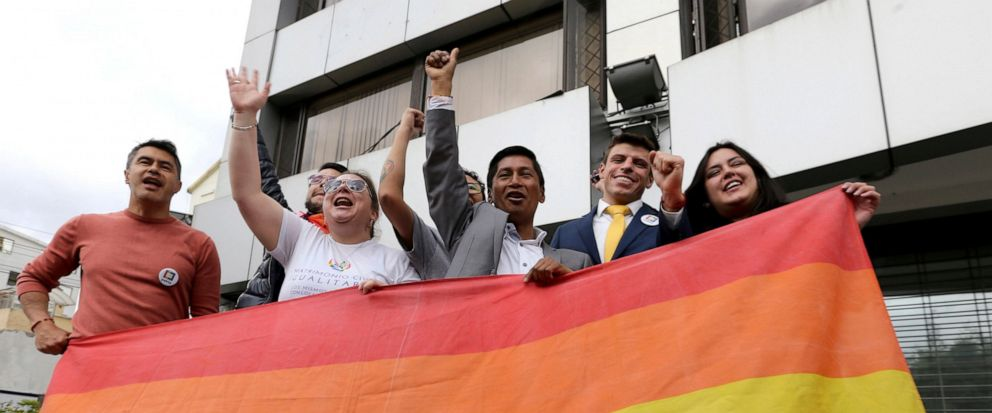 Efrain Soria, center, celebrates with other leaders of the gay community after the legalization of same-sex marriage, outside the court in Quito, Ecuador, Wednesday, June 12, 2019. Ecuador now joins a handful of Latin American nations — Argentina, Br